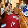 Mary Reneau talks with her husband on the telephone while she looks at the floor of her dining room, now littered with broken china, glassware and other sentimental keepsakes that were damaged when tossed to the floor during an earthquake in the early morning hours of Saturday, Nov. 5. , 2011. Doors of her furniture flew open and drawers were edged slightly open during the quake. Mary and her husband, Joseph were awakened around 2:15 a.m. when their house shook and items began falling off the walls and form shelves and cabinets inside their two-story brick ranch-style home in rural Lincoln County, about six miles northwest of Prague. Austin Holland, a seismologist with the Oklahoma Geological Survey, placed the quake\'s epicenter within two to three miles of the Reneau home. The Reneaus have lived in their house for 25 years. Photo by Jim Beckel, The Oklahoman