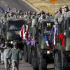Photo - Photo by Jim Beckel, The Oklahoman The city of Midwest City teamed with civic leaders and local  merchants to display their appreciation for veterans and active  military forces by staging a Veterans Day parade that stretched more than a mile and a half along three of the city's busiest streets Monday morning. View more photos on Page 3A.