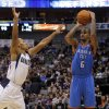 Oklahoma City\'s Eric Maynor (6) shoots over Dallas\' Jerome Randle during the pre season NBA game between the Dallas Mavericks and the Oklahoma City Thunder at the American Airlines Center in Dallas, Sunday, Dec. 18, 2011. Photo by Sarah Phipps, The Oklahoman