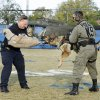 Harrah Police Officer Phil Stewart holds police dog