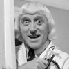 Photo - FILE - This is Jan 1, 1972 file photo of Jimmy Savile visiting the patients and staff of Leeds General Infirmary in Leeds northern England. Leeds General Infirmary was not only healthcare institution where Jimmy Savile carried out his abuse. Allegations relating to the broadcaster have been made in relation to hospitals, hospices  across Britain  published in a report Thursday June 26, 2014 (AP Photo/PA, File) UNITED KINGDOM OUT