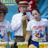 Sonya Thomas, right, reacts after winning the Nathan's Famous Fourth of July International Hot Dog Eating contest with 36 3/4 hot dogs and buns at Coney Island. AP Photos
