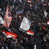 Egyptian demonstrators march from Moustafa Mahmoud mosque towards Tahrir Square in Cairo, Egypt, Friday, Jan. 25, 2013. Two years after Egypt\'s revolution began, the country\'s schism was on display Friday as the mainly liberal and secular opposition held rallies saying the goals of the pro-democracy uprising have not been met and denouncing Islamist President Mohammed Morsi. Banner in center shows an image of Egyptian feminist, Hoda Shaarawi who called for Egyptian women to remove the veil in 1922. (AP Photo/Ahmed Abd el Fattah) ORG XMIT: CAI106