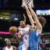 Oklahoma City Thunder\'s Russell Westbrook (0) drives past New Orleans Hornets\' Robin Lopez (15) during the NBA basketball game between the Oklahoma CIty Thunder and the New Orleans Hornets at the Chesapeake Energy Arena on Wednesday, Dec. 12, 2012, in Oklahoma City, Okla. Photo by Chris Landsberger, The Oklahoman