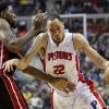 Photo - Detroit Pistons forward Tayshaun Prince (22) drives against Miami Heat forward Udonis Haslem during the first half of an NBA basketball game Friday, Dec. 28, 2012, in Auburn Hills, Mich. (AP Photo/Duane Burleson)