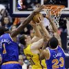 Photo - Indiana Pacers' Tyler Hansbrough (50) shoots against New York Knicks' Amare Stoudemire (1) and Marcus Camby (23) during the first half of an NBA basketball game, Thursday, Jan. 10, 2013, in Indianapolis. (AP Photo/Darron Cummings)