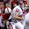 Photo - Oklahoma's Landry Jones (12) is sacked by Nebraska's Phillip Dillard (52) during the first half of the college football game between the University of Oklahoma Sooners (OU) and the University of Nebraska Cornhuskers (NU) on Saturday, Nov. 7, 2009, in Lincoln, Neb.  Photo by Chris Landsberger, The Oklahoman ORG XMIT: KOD