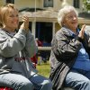 Lynn Etter and JoAnn Hopkins of Norman applaud the music at a Bluegrass Festival at Ruth Updegraff Park in Norman, Okla. on Saturday, April 18, 2009. Photo by Steve Sisney, The Oklahoman