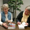 Mystery author, Carolny G.Hart, pictured right, signs book for Carolny Sims. The book signing was held recently at Rose State College Community Photo By: Steve Reeves Submitted By: natalie,