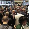 Photo -   Traders crowd a a Barclays booth during early trading on the floor of the New York Stock Exchange on Tuesday, Nov. 20, 2012. Stocks sank early Tuesday on Wall Street. Hewlett-Packard stock suffered a big decline after its executives said that a company HP bought for $10 billion last year lied about its finances. (AP Photo/Bebeto Matthews)