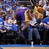 Los Angeles\' Metta World Peace (15) falls into fans during Game 2 in the second round of the NBA playoffs between the Oklahoma City Thunder and L.A. Lakers at Chesapeake Energy Arena in Oklahoma City, Wednesday, May 16, 2012. Oklahoma City won 77-75. Photo by Bryan Terry, The Oklahoman