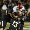 Damien Williams is stopped by three Baylor tacklers during first half action of the NCAA college football game between the University of Oklahoman (OU) Sooners and the Baylor Bears at Floyd Casey Stadium in Waco, Texas, Thursday, Nov. 7, 2013. Photo by Jim Beckel, The Oklahoman