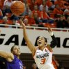 Photo - Oklahoma State's Tiffany Bias (3) goes to the basket past Stephen F. Austin's Tierany Henderson (31) during a women's college basketball game between Oklahoma State University and Stephen F. Austin at Gallagher-Iba Arena in Stillwater, Okla., Thursday, Dec. 6, 2012.  Photo by Bryan Terry, The Oklahoman