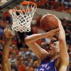 KU\'s Cole Aldrich (45) tries to keep control of the ball next to OSU\'s James Anderson (23) in the second half during the men\'s college basketball game between the University of Kansas (KU) and Oklahoma State University (OSU) at Gallagher-Iba Arena in Stillwater, Okla., Saturday, Feb. 27, 2010. OSU won, 85-77. Photo by Nate Billings, The Oklahoman