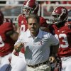 Alabama head coach Nick Saban leads his team on to the field for an NCAA college football game against Tennessee in Tuscaloosa, Ala., Saturday, Oct. 26, 2013. (AP Photo/Dave Martin)