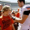 Photo - OSU's Wes Lunt signs the shirt of twelve-year-old Luke Fritzler of Enid after Oklahoma State's spring football game at Boone Pickens Stadium in Stillwater, Okla., Saturday, April 21, 2012. Photo by Bryan Terry, The Oklahoman