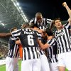 Photo - Juventus players celebrate after their teammate Simone Padoin, at center, scored during a Serie A soccer match between Juventus and Atalanta at the Juventus stadium, in Turin, Italy, Monday, May 6, 2014. (AP Photo/Massimo Pinca)