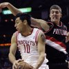 Houston Rockets\' Carlos Delfino (10) grabs a rebound from Portland Trail Blazers\' Meyers Leonard in the first half of an NBA basketball game on Saturday, Nov. 3, 2012, in Houston. (AP Photo/Pat Sullivan)
