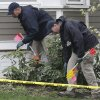 Investigators work near the location where the previous night a suspect in the Boston Marathon bombings was arrested, Saturday, April 20, 2013, in Watertown, Mass. Police captured Dzhokhar Tsarnaev, 19, the surviving Boston Marathon bombing suspect, in a backyard boat after a wild car chase and gun battle earlier in the day left his older brother dead. (AP Photo/Matt Rourke) ORG XMIT: MAMR111