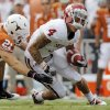 Blake Gideon (21) of Texas tackles Kenny Stills (4) of OU after a catch in the first half during the Red River Rivalry college football game between the University of Oklahoma Sooners (OU) and the University of Texas Longhorns (UT) at the Cotton Bowl in Dallas, Friday, Oct. 7, 2011. Photo by Nate Billings, The Oklahoman