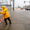 "An Oklahoma City worker attaches a ""road closed"
