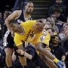 Golden State Warriors\' Harrison Barnes (40) drives the ball past San Antonio Spurs\' Gary Neal during the first half of an NBA basketball game Friday, Feb. 22, 2013, in Oakland, Calif. (AP Photo/Ben Margot)