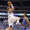 Dirk Nowitzki (41) of Dallas shoots the ball beside Oklahoma City\'s Thabo Sefolosha (2) during game 1 of the Western Conference Finals in the NBA basketball playoffs between the Dallas Mavericks and the Oklahoma City Thunder at American Airlines Center in Dallas, Tuesday, May 17, 2011. Photo by Bryan Terry, The Oklahoman