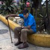 Photo - In this Feb. 19, 2014 photo, an old man rests alone in a square downtown in Caracas, Venezuela. There is plenty of discontent among the lower classes but the students have failed to capitalize on it. But Venezuela's poor are, on the whole, more worried about losing the pensions, subsidisies, education and health services gained under Chavez if the opposition were to come to power. (AP Photo/Rodrigo Abd)