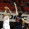 Oklahoma State\'s Brittney Martin (22) shoots in front of Texas Tech\'s Haley Schneider (31) during the women\'s college basketball game between Oklahoma State and Texas Tech at Gallagher-Iba Arena in Stillwater, Okla., , Saturday, Jan. 18, 2014. Photo by Sarah Phipps, The Oklahoman