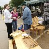 Linda Dunn, middle, and her daughter Shannon Atwell talk with H. Burke Langrall III about his custom woodwork at the Farmers Market in Edmond Saturday, May 9, 2009. Photo by Doug Hoke, The Oklahoman