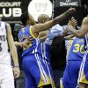 Golden State Warriors players celebrate at the buzzer as a dejected Minnesota Timberwolves\' Luke Ridnour, left, leaves the court after Golden State won 100-99 in an NBA basketball game Sunday, Feb. 24, 2013, in Minneapolis. (AP Photo/Jim Mone)