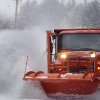 Highway crews work to clear snow from roads on Thursday, Jan. 2, 2014, in Henniker, N.H. About 6 to 10 inches of snow is expected in the southern half of New Hampshire, and up to a foot in the Seacoast area. Lesser amounts are expected farther north. The storm is expected to last into Friday morning. (AP Photo/Jim Cole)