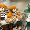 Photo -  Teddy Bears with the Energy FC logo on them are stocked by store employee Mike Lummus.    PAUL B. SOUTHERLAND -