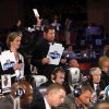 An NFL official holds up a card containing the Miami Dolphins\' selection of Utah State\'s Will Davis, the 93rd overall, during the third round of the NFL football draft, Friday, April 26, 2013, at Radio City Music Hall in New York. (AP Photo/Jason DeCrow)