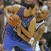 Photo - Utah Jazz's Carlos Boozer, right, reaches in on Oklahoma City Thunder's Nenad Krstic during the second half of an NBA basketball game in Salt Lake City, Saturday, Nov. 24, 2009. The Thunder beat the Jazz 104-94. (AP Photo/George Frey)