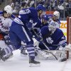 Toronto Maple Leafs goalie Jonathan Bernier, right, scrambles for the puck with teammates Joffrey Lupul (19), Paul Ranger (15) and Morgan Rielly (44) against New York Rangers\' Brian Boyle (22) and J.T. Miller (10) during the first period of an NHL hockey game in Toronto, Saturday, Jan. 4, 2014. (AP Photo/The Canadian Press, Mark Blinch)