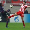 Olympiakos\' Kostas Manolas, right, fights for the ball with Arsenal\'s Gervinho during their group B Champions League soccer match in the port of Piraeus, near Athens, Tuesday, Dec. 4, 2012. (AP Photo/Thanassis Stavrakis)