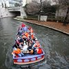 OSU fans ride a boat on the Riverwalk before the Valero Alamo Bowl college football game between the Oklahoma State University Cowboys and the University of Arizona Wildcats at the Alamodome in San Antonio, Texas, Wednesday, December 29, 2010. Photo by Sarah Phipps, The Oklahoman