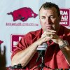 Photo - Arkansas coach Bret Bielema listens a reporter's question during NCAA college football media day in Fayetteville, Ark., Sunday, Aug. 11, 2013. (AP Photo/April L. Brown)