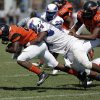 Millwood\'s Kameron Lyons (64) takes down Douglass\'s Christopher High (22) during a high school football game between Douglass and Millwood in Oklahoma City, Saturday, Sept. 8, 2012. Photo by Garett Fisbeck, The Oklahoman