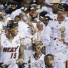 """Photo - FILE - In this June 21, 2013 file photo, Miami Heat players including LeBron James, top center, celebrate after Game 7 of the NBA basketball championship game against the San Antonio Spurs, in Miami. As he walked off the court for the final time last season, LeBron James shouted to no one in particular, """"Keep doubting me! I need it!"""" He and the Heat seem to have plenty of doubters now, and James knows there's only one way to prove them wrong. (AP Photo/Wilfredo Lee, File)"""