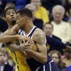 Indiana Pacers\' Paul George, left, battles Oklahoma City Thunder\'s Thabo Sefolosha for a rebound during the first half of an NBA basketball game on Friday, April 5, 2013, in Indianapolis. (AP Photo/Darron Cummings) ORG XMIT: NAF101