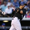 Photo - Colorado Rockies' Carlos Gonzalez singles against the Chicago Cubs in the fourth inning of a baseball game in Denver on Wednesday, Aug. 6, 2014. (AP Photo/David Zalubowski)