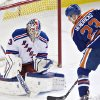New York Rangers goalie Cam Talbot (33) makes the save on Edmonton Oilers Matt Hendricks (23) during second period NHL hockey action in Edmonton, Alberta, on Sunday March 30, 2014. (AP Photo/The Canadian Press, Jason Franson)