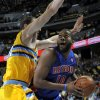 Detroit Pistons center Greg Monroe (10) looks to shoot over Denver Nuggets center Kosta Koufos (41) during the first quarter of an NBA basketball game, Tuesday, Nov. 6, 2012, in Denver. (AP Photo/Jack Dempsey)