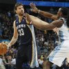 Memphis Grizzlies center Marc Gasol, left, of Spain, looks to pass the ball under pressure from Denver Nuggets forward Kenneth Faried in the first quarter of an NBA basketball game in Denver, Friday, March 15, 2013. (AP Photo/David Zalubowski)