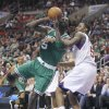Boston Celtics\' Kevin Garnett ,left drives against Philadelphia 76ers\' Arnett Moultrie (5) in the first half of an NBA basketball game, Tuesday, March 5, 2013, in Philadelphia. (AP Photo/H. Rumph Jr)