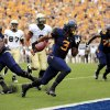 West Virginia running back Charles Sims (3) crosses scores a touchdown during the first quarter of aneir NCAA college football game against William and Mary in Morgantown, W.Va., on Saturday, Aug. 31, 2013. (AP Photo/Christopher Jackson ORG XMIT: WVCJ103