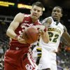 Photo - OU's Cade Davis and Baylor's A.J. Watson fight for the ball during the college basketball Big 12 Championship tournament game between the University of Oklahoma and Baylor in Kansas City, Mo., Wednesday, March 9, 2011. Photo by Bryan Terry, The Oklahoman