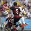 United States\' Clint Dempsey is defended by Germany\'s Mats Hummels during the group G World Cup soccer match between the USA and Germany at the Arena Pernambuco in Recife, Brazil, Thursday, June 26, 2014. (AP Photo/Ricardo Mazalan)